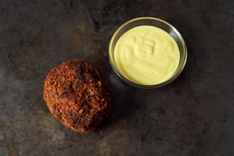 Scotch Eggs. Scotch eggs are hard-boiled eggs wrapped in sausage, battered, and deep-fried. That description alone should be enough to win your heart. But if it's not, just think of the tangy mustard sauce that goes along with it.