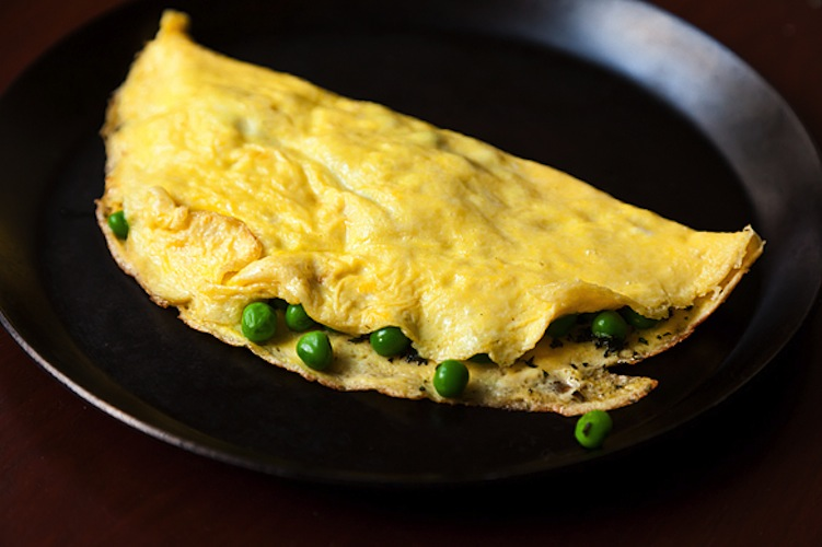 Petite Pea Omelet with Mint and Mascarpone. Forget all those fancy techniques for making omelets. When you mix together egg yolks and tangy mascarpone, you'll come away with a rich and delicious omelet without any of those fancy whisking techniques. Don't worry about finding petite peas—any vegetable you've got on hand will be happy to be sandwiched in a fluffy omelet.