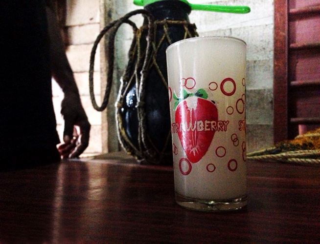 The freshly tapped toddy was sweet, slightly fizzy, with a distinct coconut flavor.