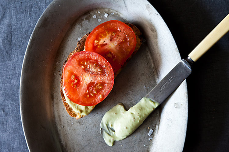 A Tomato Sandwich Worthy of a Little Bacon. We take bacon seriously, so when we say a sandwich is worthy of bacon, you know it's good. Here's a simple sandwich that takes advantage of the summer's juiciest, most beloved item—the tomato—and makes it even better with the addition of avocado-bacon aioli.