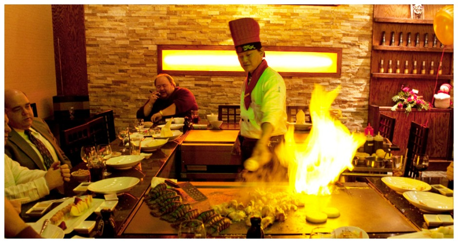 Try Hibachi-style dining. This concept's simple: You sit facing the chef, you're mesmerized as he tosses and twirls his knives and tongs, and in your supremely entertained state you don't care that you're eating alone. We call this a win-win situation. [Photo: Mitsuba Restaurants]