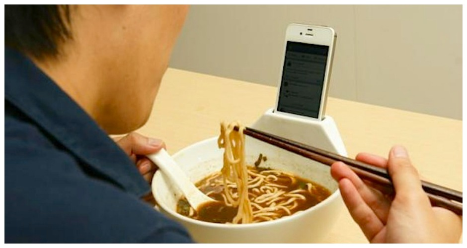 Or the Anti-Loneliness Ramen Bowl The age-old question, How do you stay entertained AND eat ramen (or anything else) if one of your hands is busy holding a phone? has finally been answered.  this device allows you to prop your smartphone in the holder at the edge of the bowl and slurp away. [Photo: MisoSoupDesign via CNET]
