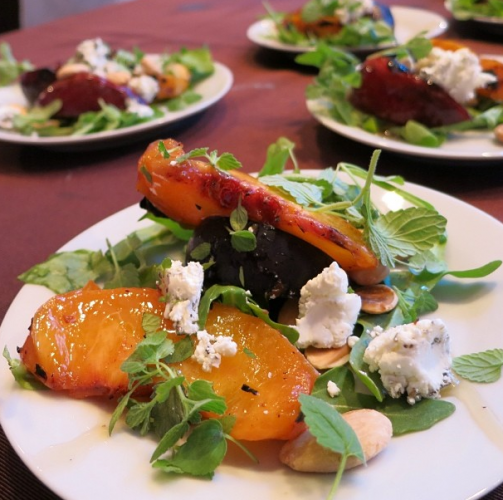The Hearty Boys served grilled stone fruit salad with Marcona almonds and goat cheese at the Food & Wine Fest Grand Tasting. (Photo: