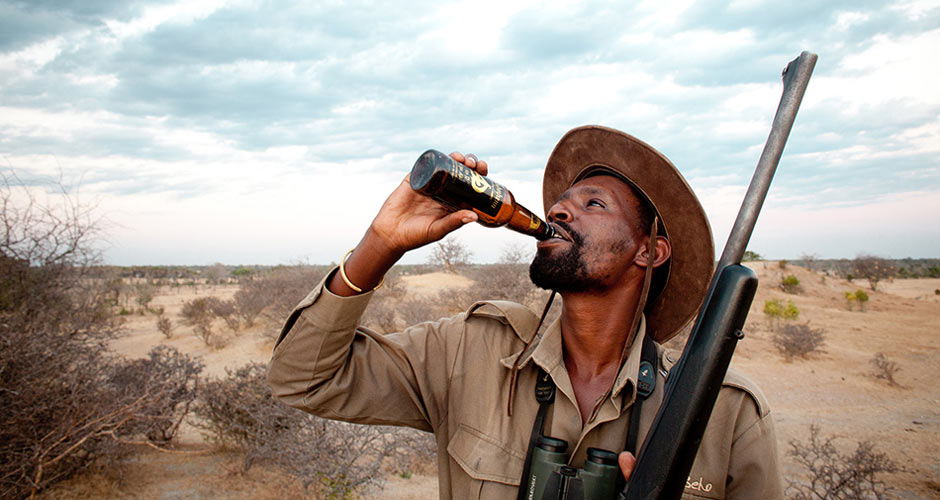 """""""This photo is of my Safari guide, Onesmo, finishing off a bottle of"""