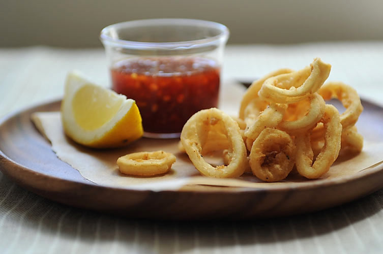 Sweet & Spicy Calamari. Say goodbye to heavy, thick calamari dripping in oil. Great calamari is coated only in a simple mixture of flour, salt, and pepper before it's fried. That means crisp, crunchy rings that you won't be able to stop eating. And before you think that this recipe is plain or boring, just take a taste of the chili dipping sauce spiked with honey and sesame oil.