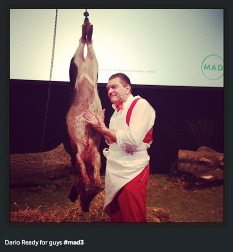 Famed Italiani butcher Dario Cecchini began his talk at MAD3 by walking onto the stage to AC/DC and slicing a pig open. (Photo: