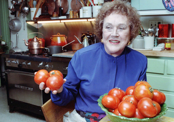Julia shows off tomatoes in the kitchen at her home in Cambridge, MA, in 1992. (Photo: Associated Press)