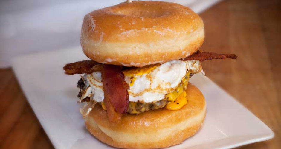 The Bacon-Donut Burger (Luther Burger). This is a hamburger or cheeseburger with one or more glazed doughnuts in place of the bun. These sandwiches tend to run between approximately 800 and 1,500 calories, because you need to fulfill your daily caloric needs in one sitting. (Photo: