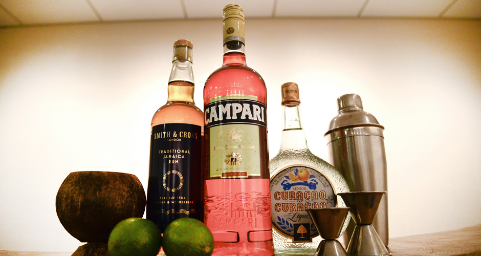 All you need for an epic Rum Day is: Campari, Smith & Cross Jamaican rum, orgeat, Curaçao, and lime juice. And maybe a few coconut glasses, cocktail umbrellas, and bamboo straws.