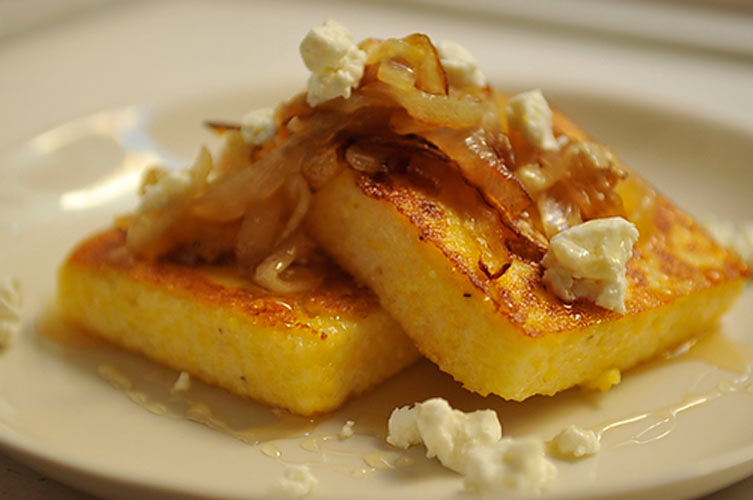 Griddled Polenta Cakes with Caramelized Onions, Goat Cheese, and Honey. Savory and sweet thanks to the combination of cheese and honey, this dish is still firmly in the entree camp, and can serve as a satisfying main course for meat eaters and vegetarians alike.