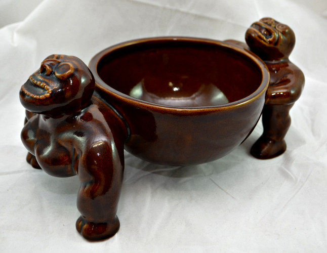 Sip from this scorpion bowl while you ponder what the hell is holding it up. Available at Ebay