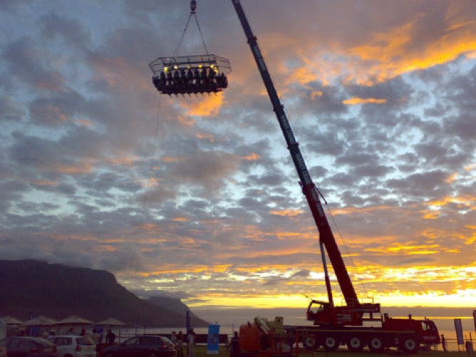 Dinner In The Sky, International. Apparently, Dinner In The Sky is a real thing. For a shit ton of money, you can reserve to set up a crane that will hoist a dining platform nearly 200 feet high, and comes complete with table, chairs, and a kitchen. The dining experience costs a mere $290 a head. (Photo: