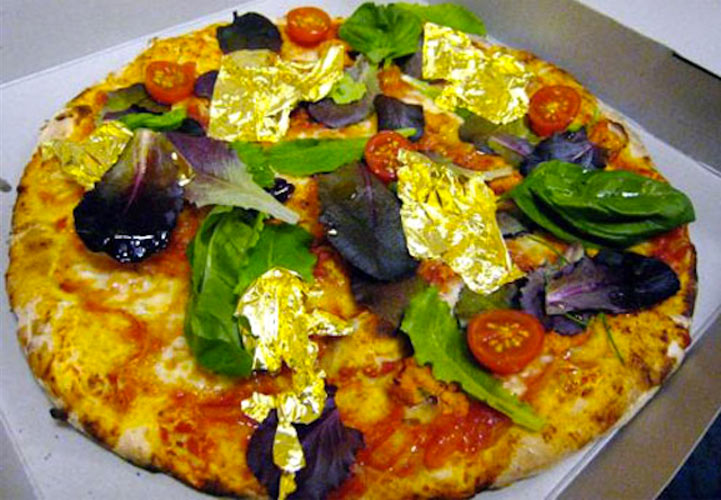 """Name: White Truffles and Gold Pizza Cost: $2,400 Where it came from: Margo's Pizzeria, Malta   What it is: This world record-setting pie featured 100 grams of 6,500 EUR per kilo (approximately $8,576 per lb) white truffles, along with 24-carat gold leaf. """"This is not just a pizza;  this is a sign from God telling us how  great She is,"""" says the restaurant's menu. Chic Overdose)"""