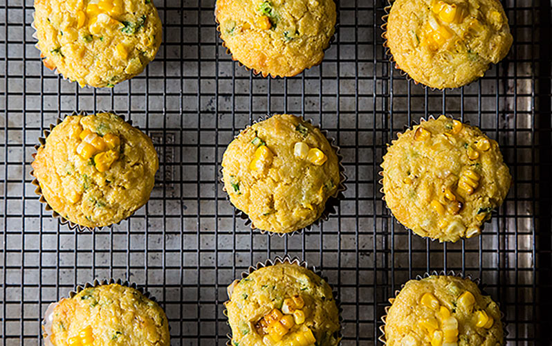 Double Corn, Quinoa & Cheddar Muffins. Vegetarians will be happy to know that quinoa is a complete protein, so these muffins are actually meal-worthy. Add southern-style collard greens and you'll have meat eaters ditching whatever else you brought to get a plate full of this southern duo.