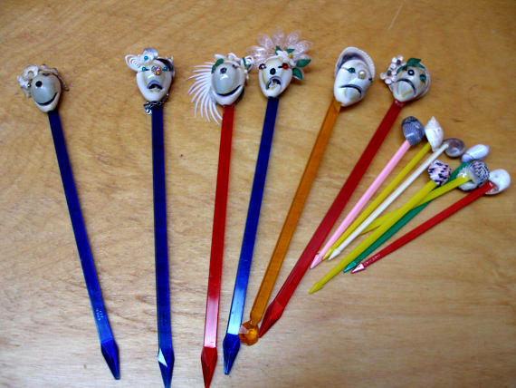 Stir your drink while you think about someone actually hand-making these shrunken-head swizzle sticks. Available at Etsy