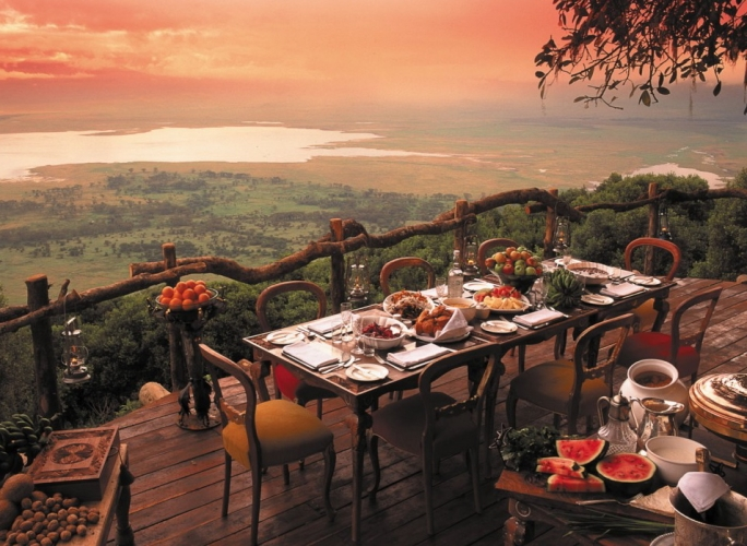Ngorongoro Crater Lodge, Ngorongoro Conservation Area, Tanzania. While technically a hotel, this quaint African resort is undoubtedly one of the most magnificent places to dine. The lodge is perched on the edge of the largest unbroken volcanic caldera in the world, and wildlife roam the crater floor.(Photo: