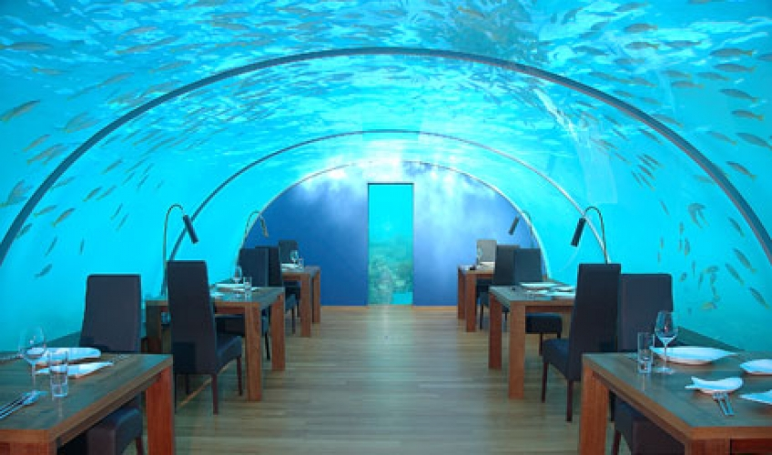 Ithaa, Maldive. Ithaa is part of Hilton Maldives Resort & Spa. It is the first ever restaurant fully immersed in water, surrounded by enormous fish. It sits 5 meters below sea level in the Indian Ocean. This place better have great seafood. (Photo: