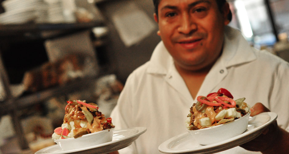Here's Eduardo, the inventor of Mile End poutine nachos, with his fabulous creation.