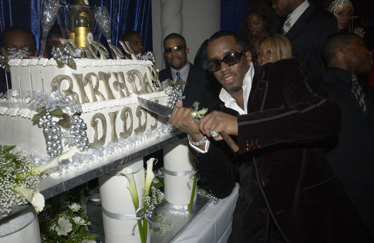 Who: DiddyLevel of absurdity (0-10): 6 A shiny cake for Mr. Shiny Suit Man. (Photo: KMazur/WireImage)