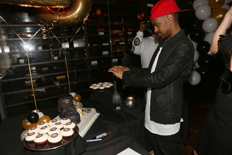 Who: Big SeanLevel of absurdity (0-10): 6 OF COURSE BIG SEAN GOT CUPCAKES INSTEAD OF A REAL CAKE. HAHAHAHA.  (Ok, there is a cake too, but stilll...cupcakes, doggy?)(Photo: Johnny Nunez/WireImage)