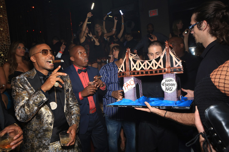 Who: NasLevel of absurdity (0-10): 7 The absurdity of the Queensboro Bridge cake is only trumped slightly by the absurdity of Nas' outfit.(Photo: Gabe Ginsberg/WireImage)