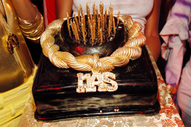 Who: NasLevel of absurdity (0-10): 5 This cake is actually pretty dope, and it makes sense for Nas, who has always been a fan of the iconic gold dookie-rope.  (Photo: Ray Tamarra/Getty Images)