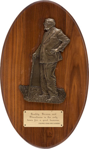 """Colonel Sanders """"Quality"""" Plaque Opening bid: $100Inscribed: """"Quality, Service and Cleanliness is the only basis for a good business. Colonel Harland Sanders""""."""