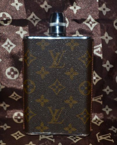 Louis Vuitton makes  a gorgeous flask for the d-bag that's eager to drop $800. Available at: Ebay)