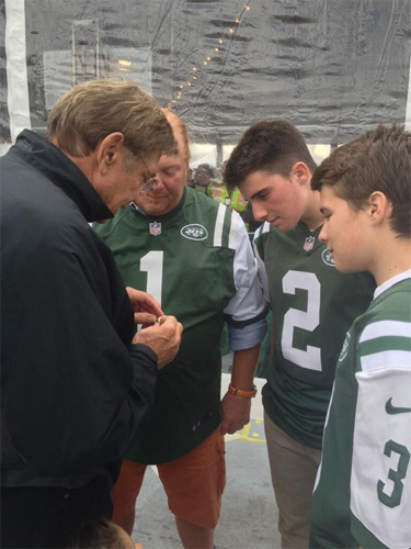 Here is a photo of Joe Naismith showing his Super Bowl ring to Mario Batali and sons. (Photo: