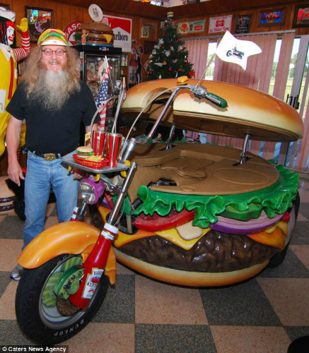 And rides around on a 'Hamburger Harley' which has ketchup bottle spokes. (Photo: Caters News Agency)
