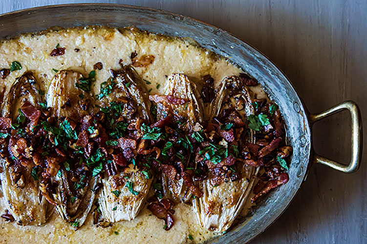 Cream Baked Endive with Bacon and Pecans. Endive browned to perfection and then slathered in a cheesy cream sauce, topped with bacon and pecans? That's exactly how we like our lettuce on a chilly fall evening.