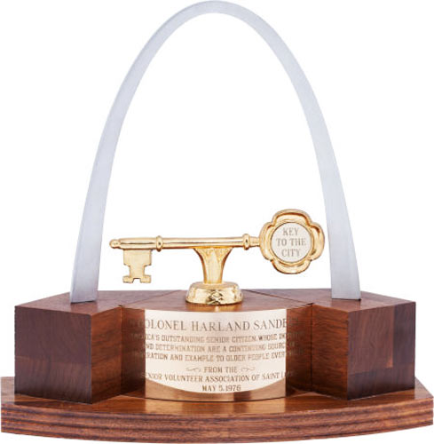 """Key to the city of St. Louis presented to Colonel Sanders Opening bid: $75The Key to City of St. Louis was presented to the Colonel when he was 85 years of age. The inscription reads """"Presented to Colonel Harland Sanders, America's Outstanding Senior Citizen, whose initiative and determination are a continuing source of inspiration and example to older people everywhere. From the Senior Volunteer Association of St. Louis, May 5, 1976."""""""