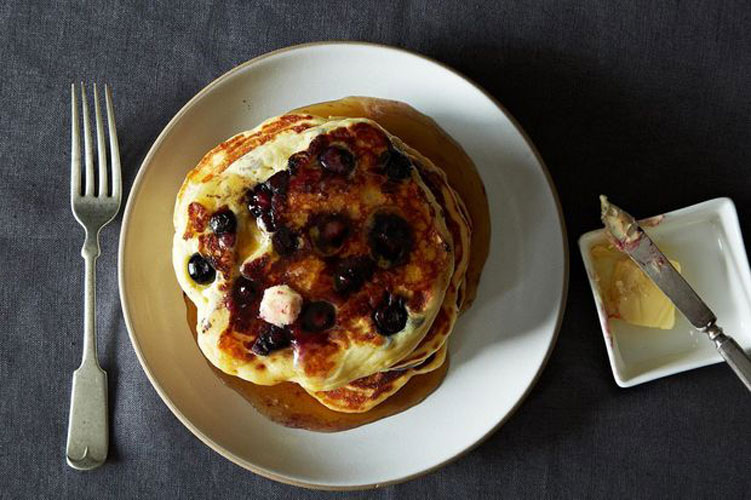 Lemony Cream Cheese Pancakes with Blueberries. These pancakes are definitely not your run-of-the-mill, in-need-of-loads-of-butter-and-syrup flapjacks. The addition of lemon juice and zest adds a tangy fragrance that wafts gently from the cakes, while cream cheese blended gently into the batter adds creamy pockets of flavor. Try them with honey or jam, or just eat them plain—they're perfect as is.