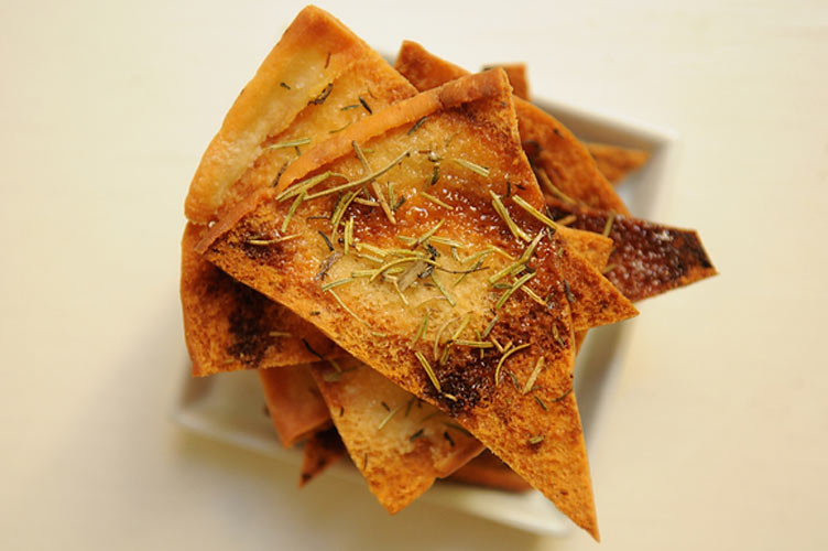 Rosemary Thyme Pita Chips. Contrary to popular belief, not all pita chips are created equal. This version, spread with both butter and honey before baking and dusted generously with dried herbs is extra rich, slightly sweet, and downright fragrant.