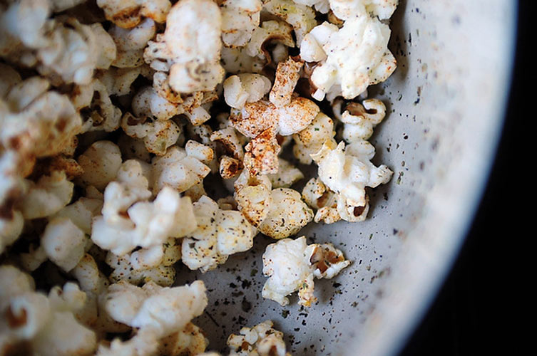 Party Popcorn. Hot paprika, salt, and marjoram make run-of-the-mill microwaved popcorn a thing of snacks past.