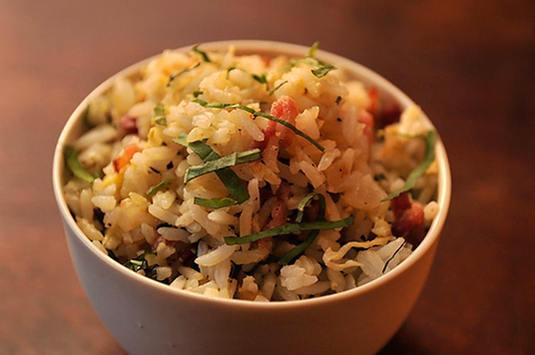 Bacon and Shiso Fried Rice. This is a fried rice we could happily eat for breakfast. You get crisp bits of bacon and rice, the egg pulls the ingredients together and the shiso tops it all off, singing with a licorice-mint fragrance. If you can't find shiso, substitute a combination of mint and basil.