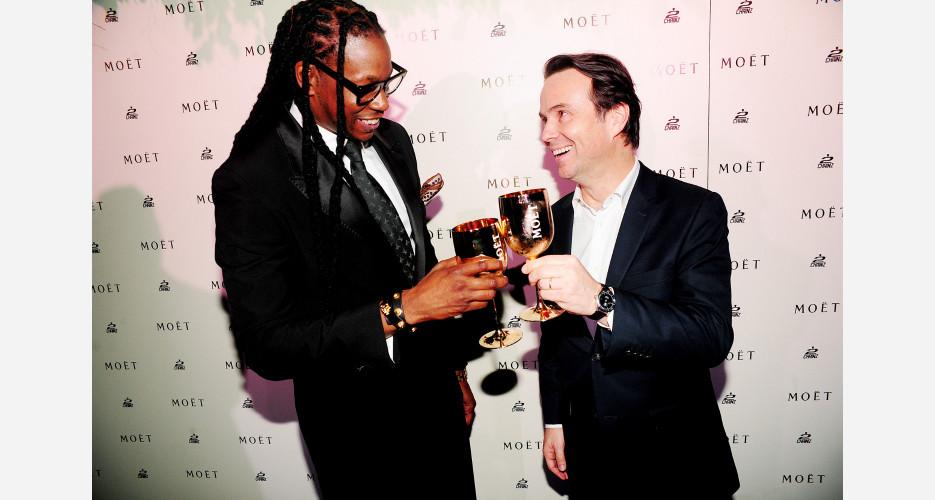 2 Chainz toasts with Moët & Chandon President, Thomas Bouleuc. Photo: KirillWasHere