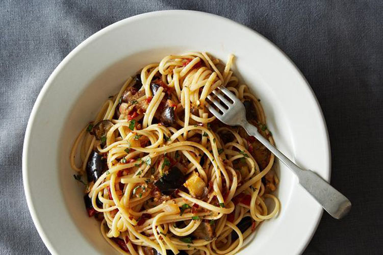 Spicy Eggplant Pasta. A hearty, filling pasta dish that's as crowd pleasing as it is vegetarian friendly. And it only calls for 9 ingredients, many of which (like canned tomatoes, chili flakes, linguine) you probably have in your pantry.