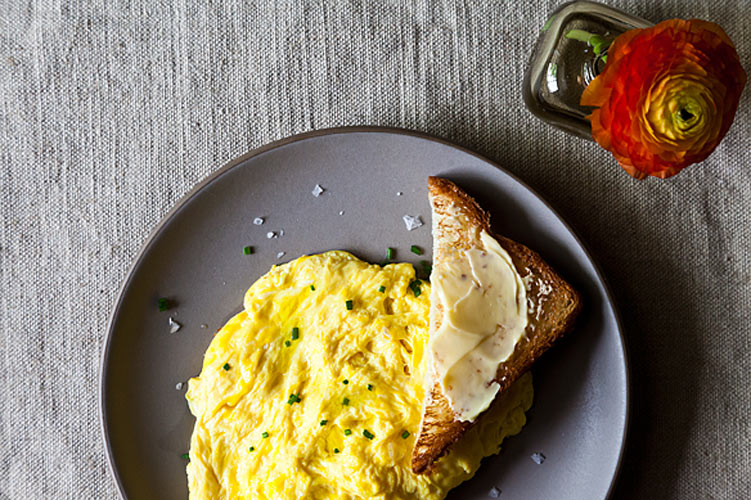 """Daniel Patterson's Poached Scrambled Eggs. An egg breakfast—a clear requirement of the Swanson household—is especially easy when making scrambled eggs is as simple as boil water, swirl in eggs, and scoop out a perfect """"scramble."""""""