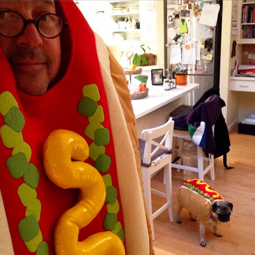 Bizarre Foods host Andrew Zimmern makes one believable wiener. Check out the hot dog pug photobombing the pic and stealing Zimmern's limelight. (Photo: