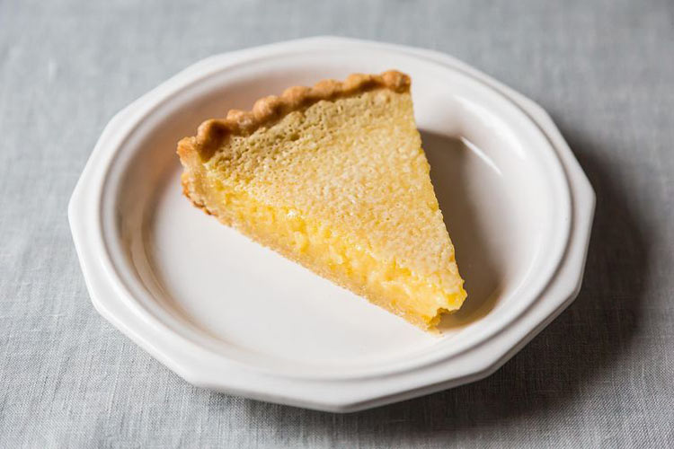 """Lazy Mary's Lemon Tart. Leslie hates laziness, but we think she'd appreciate this aptly named tart, which requires one simple step—toss all the filling ingredients (whole meyer lemons with peel, pith and all) into the blender—before you pour the mix into a tart crust and bake. This is one dessert—or """"zert"""" as Tom would say—where laziness rewards you in spades."""