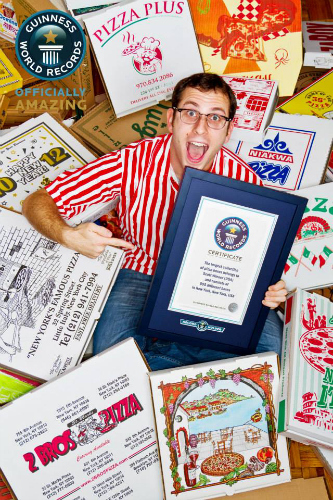 The Pizza Box King basks in his boxes and world-record-glory. (Photo: Guinness World Records Facebook)