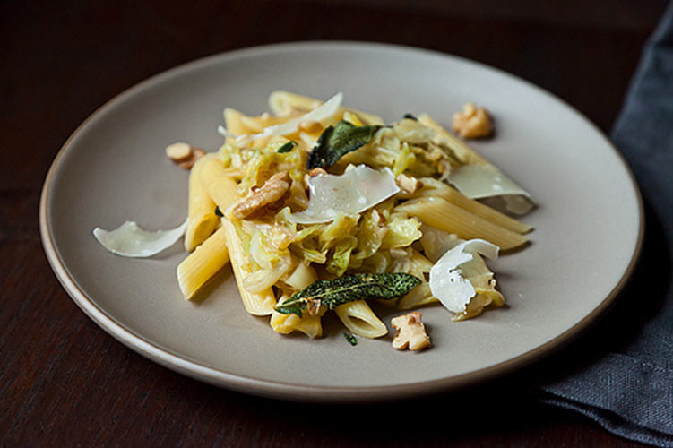 "Weeknight Pasta with Caramelized Cabbage, Sage Infused Brown Butter, and Walnuts. While not quite as easy as ""weeknight"" might suggest, any extra effort you put into this pasta will reward you with a rich, comforting meal with caramelized cabbage and decadent brown butter sauce that is bonafide comfort food for a chilly wintry day."