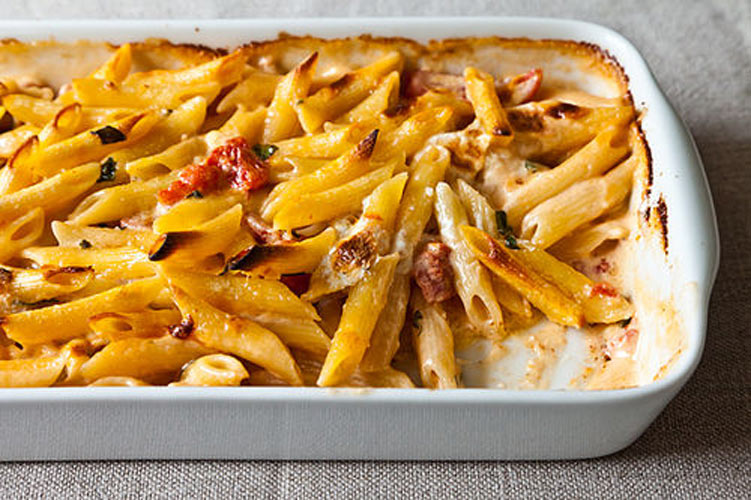 Al Forno's Penne with Tomato, Cream & Five Cheeses.  You won't meet a speedier baked pasta, not one that's this good. The recipe as written is genius, but even more genius is the fact you can apply the technique in countless ways, with whatever forgotten ends you have lying in the cheese drawer.