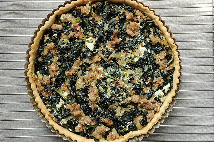 Sausage and Kale Dinner Tart. Start with flaky pastry dough and dress up the kale and sausage filling with ricotta, white wine, and fresh basil. All that's left is to bake...and name the size of your slice.