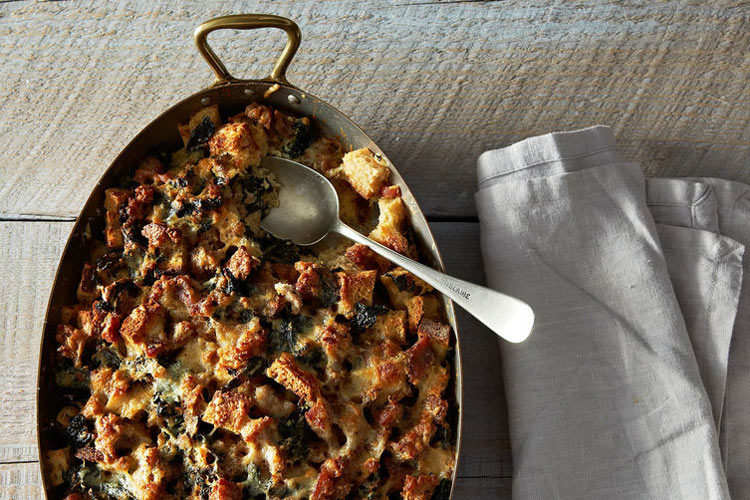 Strata with Sausage and Greens. Forget spending your morning sweating at the stove, churning out stacks of floppy pancakes. Make this savory breakfast bake streaked with cheese, sausage, and sauteed greens the night before and sleep in.