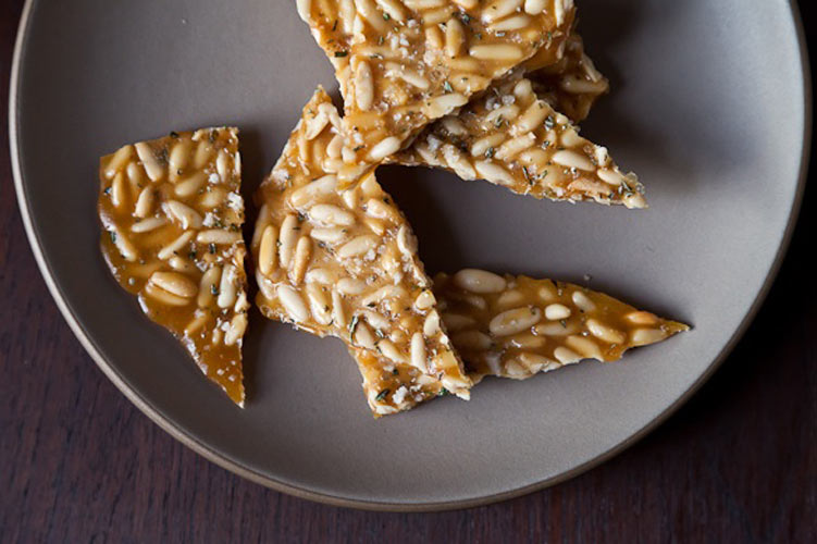 Pine Nut Brittle with Rosemary. The idea of combining pine nuts and rosemary outside of a Tuscan pasta and into a brittle? Groundbreaking. Pine nuts are cloaked in a buttery caramel, and rosemary infuses the brittle with its savory fragrance. A shower of crunchy sea salt is the finishing touch to this sweet, salty, crunchy candy.