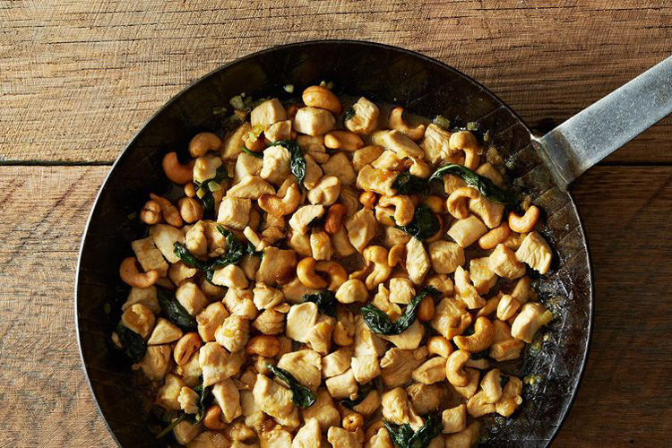 Minced Chicken and Cashews with Thai Basil. Tasty and simple. It's a very salty sauce infused with Thai basil flavor and with lots of crunchy nuts.