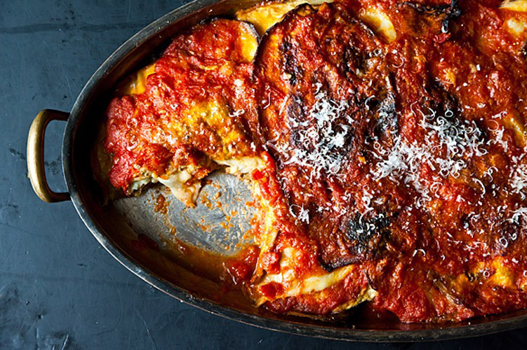 Eggplant Parmesan. When the eggplant and the tomatoes meet in a baking dish, the eggplant soaks up some tomato juices but retains its own character so you get distinct layers. Add the mozzarella as a center layer, so you get the warm melted cheese right in the belly of the dish.
