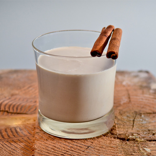 Coquito. It's traditional in Puerto Rico to make this spiced Christmastime drink. Our recipe comes from talented New York bartender Giuseppe Gonzalez. The rich elixir combines aged rum, cream of coconut, and unsweetened coconut cream with cinnamon sticks, nutmeg, and a vanilla bean. It will definitely satisfy a thirsty crowd. ¡Feliz Navidad!